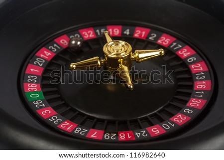 gambling roulette with calculated table - stock photo