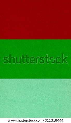 game concept - close up of three colors natural wool felt fabric material background - stock photo