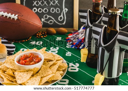 Game day football party table with beer, chips and salsa.
