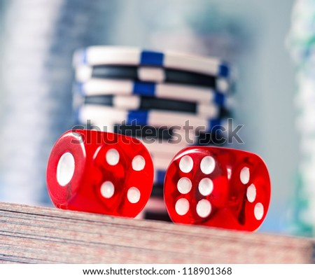 game dices with with poker chips and  playing cards