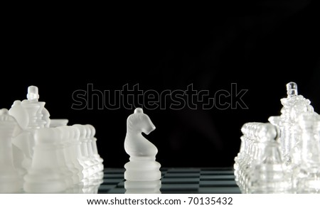 Game for leisure chess with figures on black background