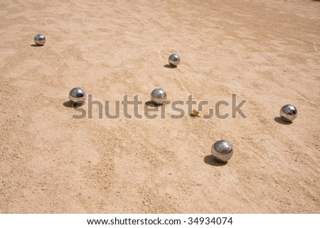 Game of jeu de boule, silver metal  balls in sand. A french ball game - stock photo