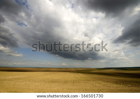 Game of light and shadows, Plough with trails on the ground, vivid spring colors