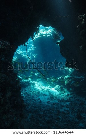 Game of lights inside the cave at Red Sea - underwater landscape - stock photo