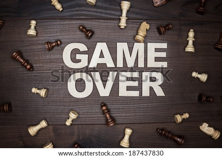 game over concept on the brown wooden background