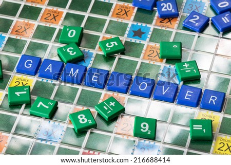 game over word on game board - stock photo