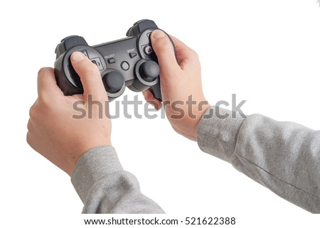 Game pad in the hands of scholar boy isolated on white