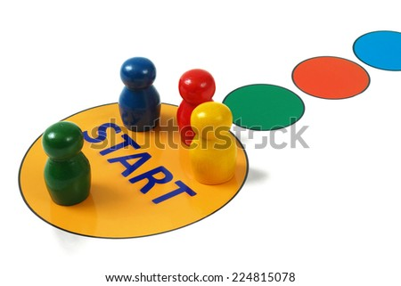 Game pegs on start field in game board - stock photo