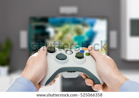 gaming game play tv fun gamer gamepad guy controller video console desktop playing player holding hobby playful enjoyment view concept - stock image