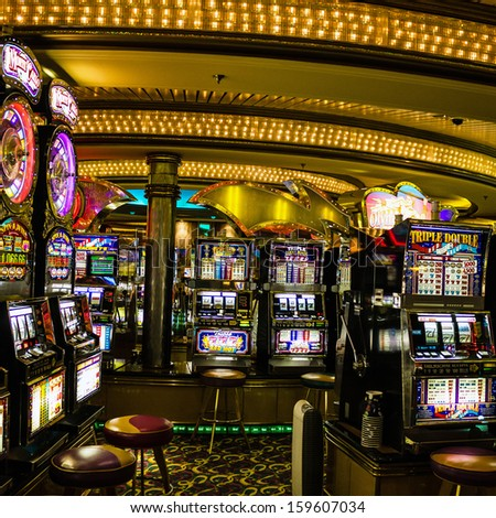 Gaming slot machines in American gambling casino in the cruise liner of Royal Caribbean International, USA
