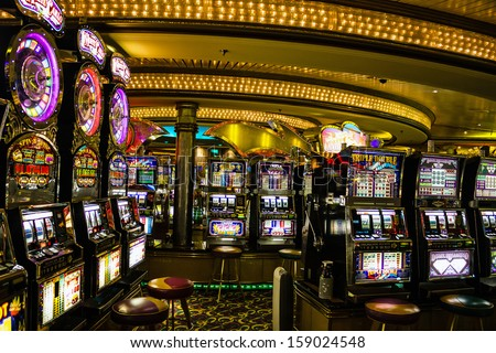 Gaming slot machines in American gambling casino in the cruise liner Vision of the Seas of Royal Caribbean International, USA.