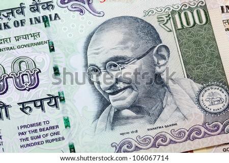 Gandhi on hundred rupee note - stock photo