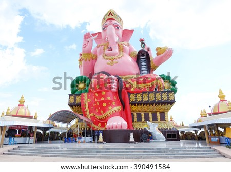 Ganesh sitting on a throne behind the sky  - stock photo