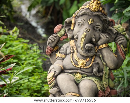 Beautiful Ganesh Statue God Of Immortality , Standing In The Garden