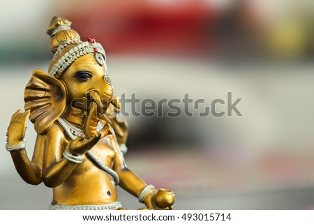 Ganesha god gold statue.