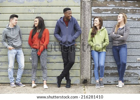 Gang Of Teenagers Hanging Out In Urban Environment - stock photo