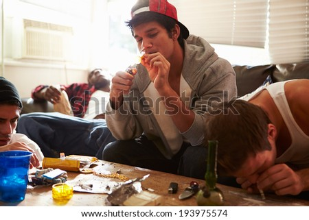 Gang Of Young Men Taking Drugs Indoors - stock photo