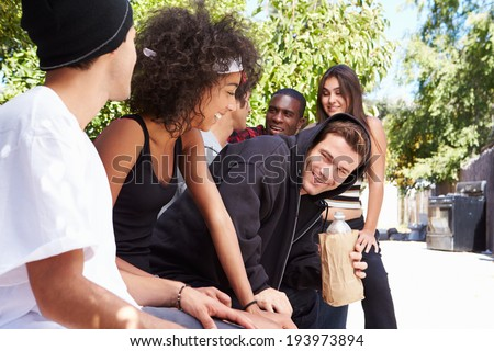 Gang Of Young People In Urban Setting Drinking Alcohol - stock photo