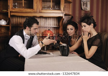 Gangster gives his beloved jewelry, retro style. - stock photo