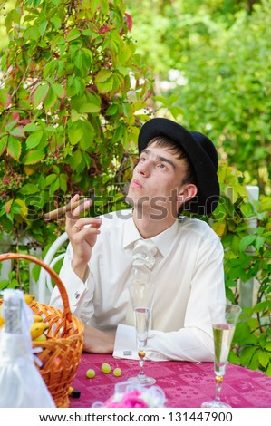 Gangster look. Handsome man with hat and cigar. Happy young groom outside on their wedding day. Wedding couple - new family! wedding dress. Bridal wedding bouquet of flowers - stock photo