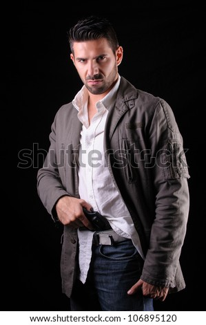 Gangster or private security or detective with a gun - stock photo