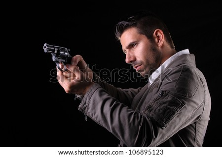 Gangster or private security or detective with a gun aiming