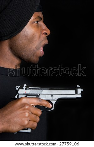 Gangster Pointing Gun - stock photo