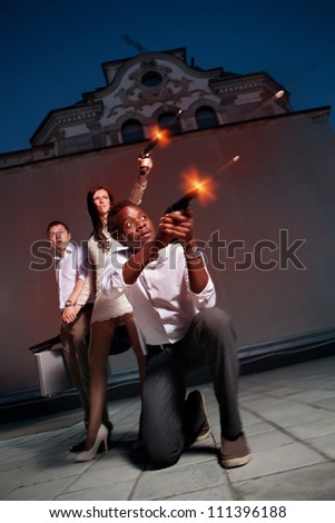 Gangster's skirmish on the evening urban background - stock photo