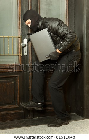 gangster steals a laptop - stock photo