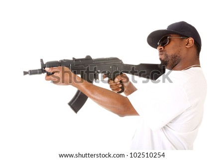 Gangster with an assault gun. - stock photo