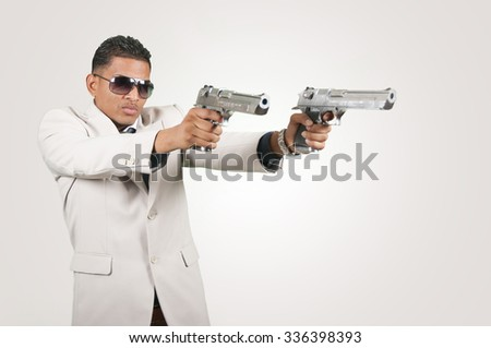 Gangster with guns on white background