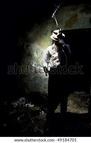 Gangster with smoke from cigar and gun - stock photo