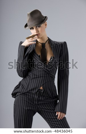 gangster woman in hat and with cigar - stock photo