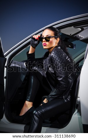 Gangster woman sit in the car - stock photo