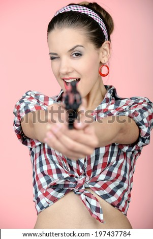 Gangster woman with pistol isolated on pink background - stock photo