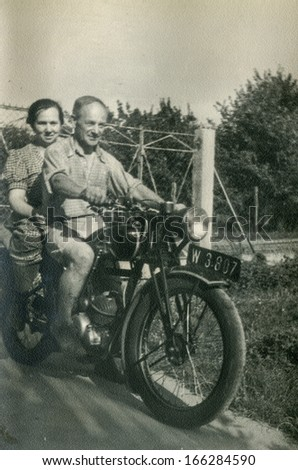 GANSERNDORF, AUSTRIA, CIRCA 1930s: Vintage photo of couple on motorbike, Ganserndorf, Austria, circa 1930s
