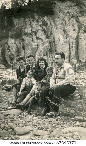 GANSERNDORF, AUSTRIA, CIRCA THIRTIES: Vintage photo of family resting outdoor, Ganserndorf, Austria, circa thirties