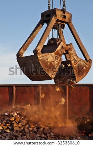 Gantry crane. Cargo handling. Industry. On blue sky background - stock photo