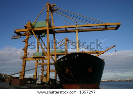 Gantry cranes and Container Ships 2 - stock photo