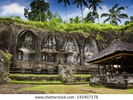 Ganung Kawi Temple. Gunung Kawi is a temple complex centered around royal tombs carved into stone cliffs in the 11th century. It is located amid scenic rice terraces about 30 minutes from Ubud. - stock photo