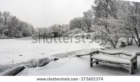 Gapstow bridge after snow storm at lake - stock photo
