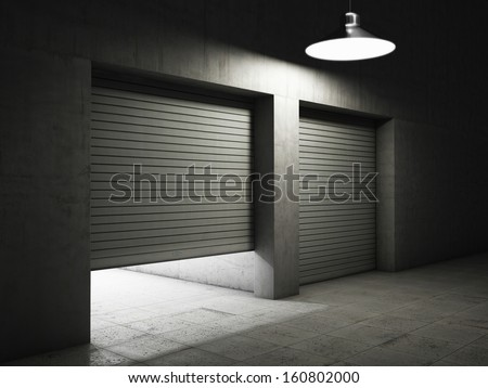 Garage building made of concrete with roller shutter doors - stock photo