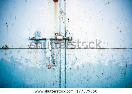 garage door locked with locker texture  - stock photo
