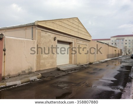Garage entrance gate perspective - stock photo