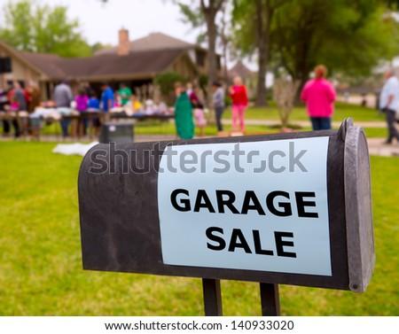 Garage sale in an american weekend on the yard green lawn - stock photo
