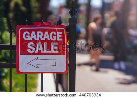 Garage Sale sign on the fence at summer day, Blurred background, flare light. Shallow DOF. - stock photo