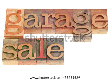 garage sale words in vintage grunge wood letterpress printing blocks, isolated on white