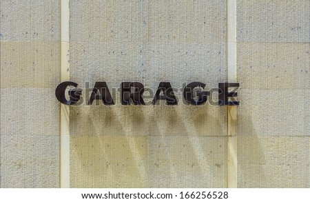 garage sign with shadow of letters - stock photo