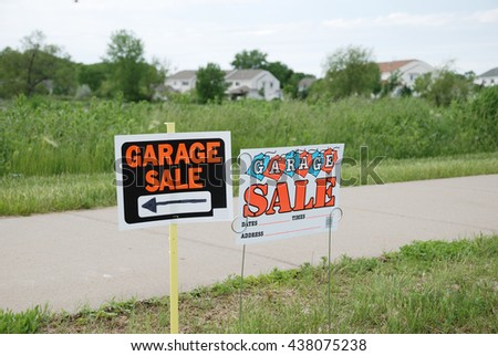 Garage signs in front of a suburban housing development, a sure sign of spring in the suburbs