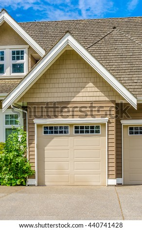 Garage with long driveway.